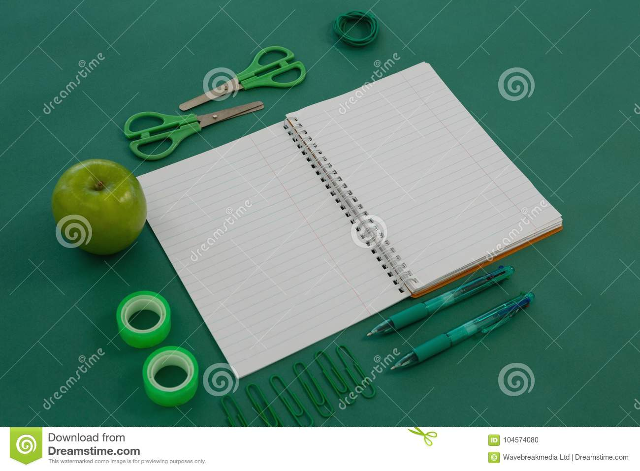 Composition of books, notepad, apple, office and glasses stock.