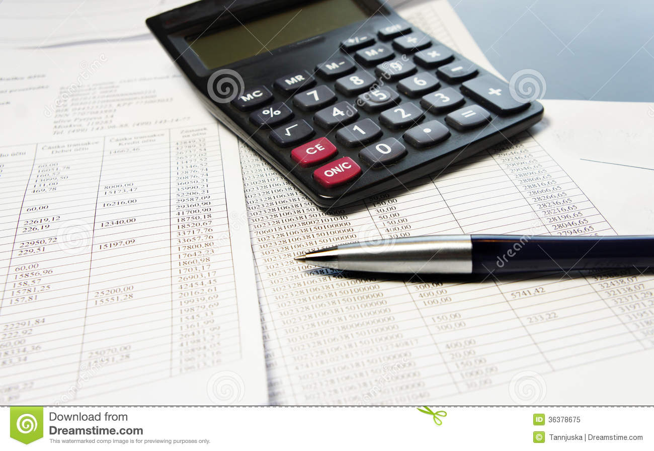 office table with calculator pen and accounting document stock