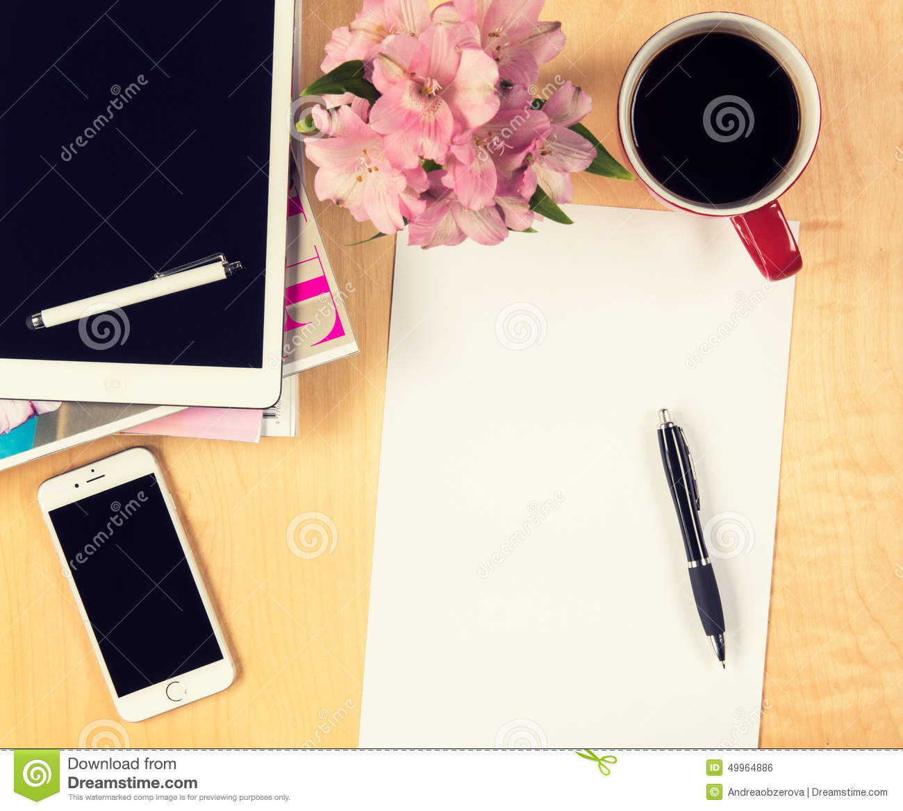 Office table with digital tablet, smartphone empty sheet of paper and cup of coffee. View from above