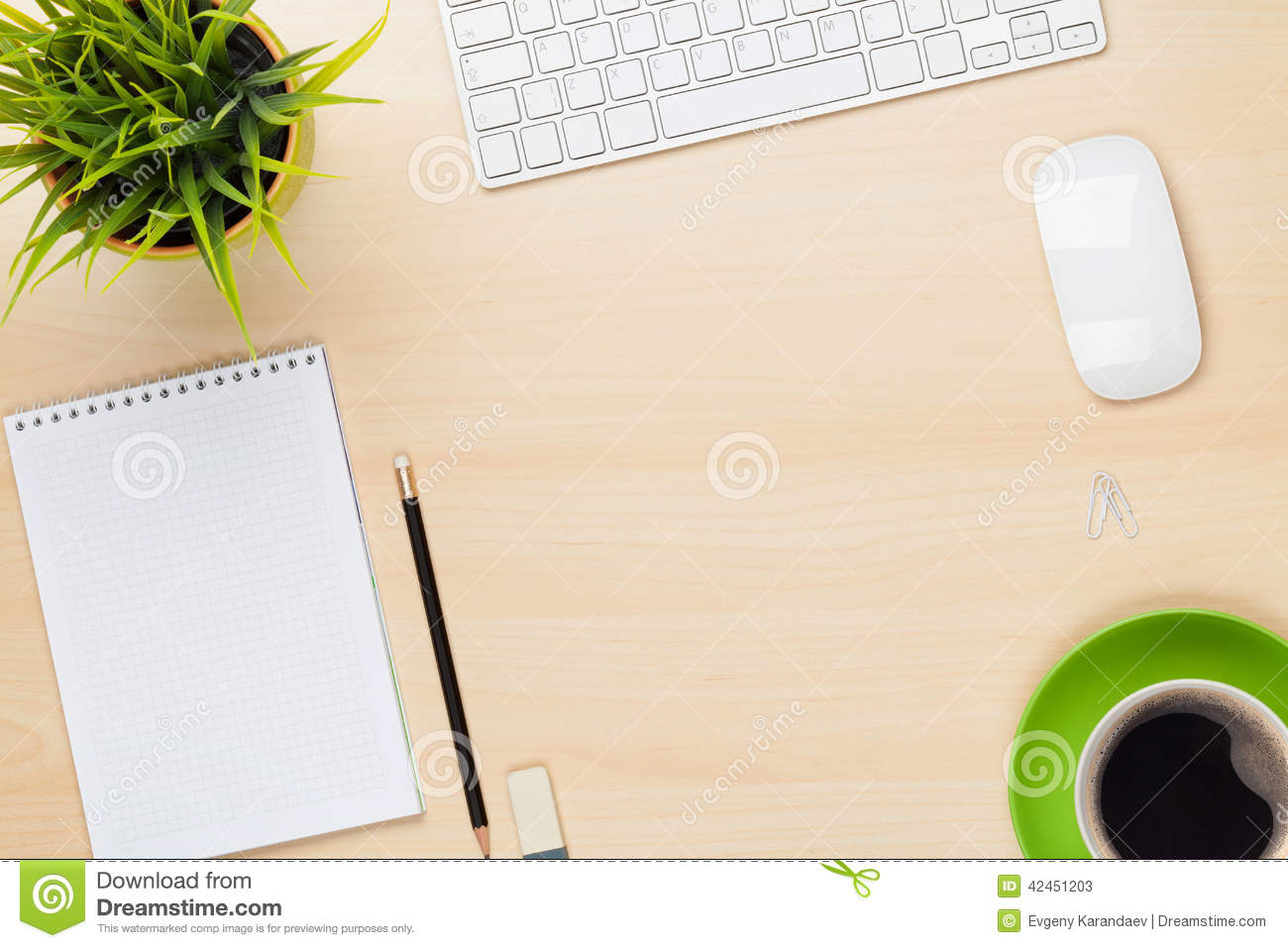 office table with notepad  computer  flower and coffee cup stock photo