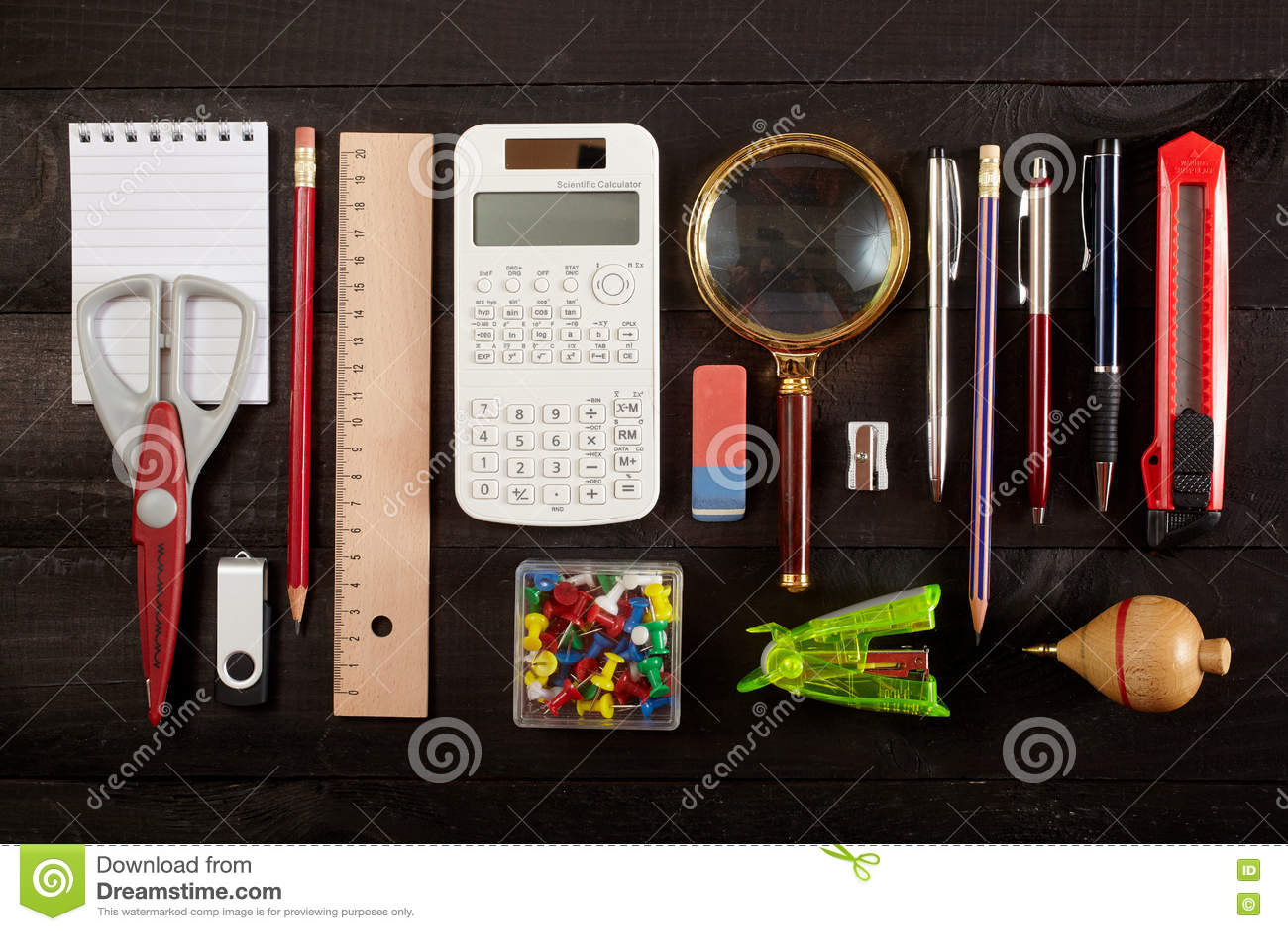 Electronic calculator scissors protractor sharpener cutter pencil.