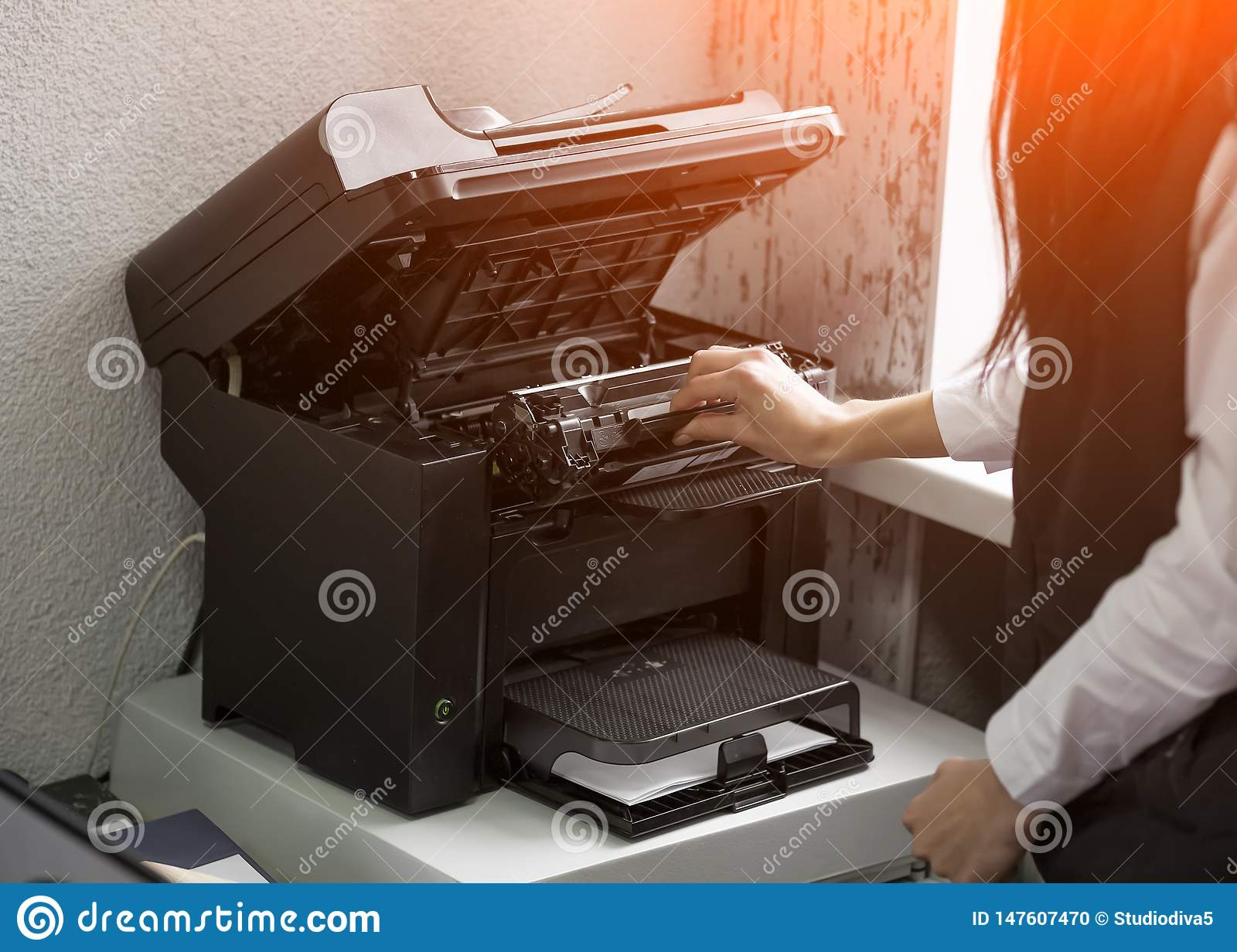 Office worker change the cartridge in a laser printer