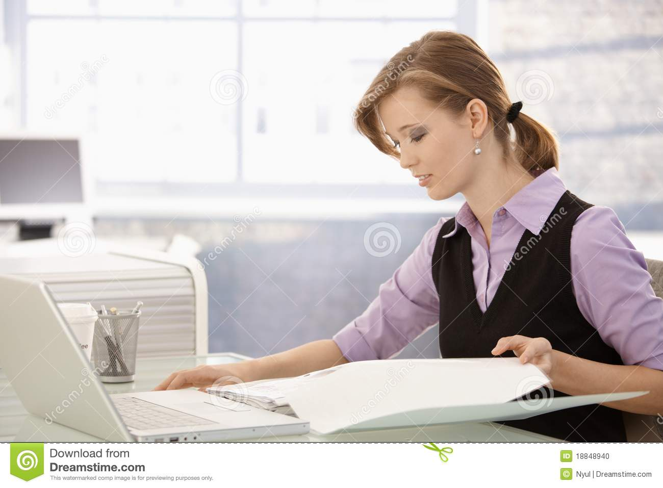 Office Worker Doing Paperwork At Desk Stock Photo - Image: 18848940