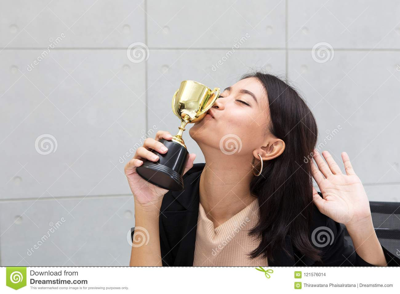 Office worker kissing trophy. A business woman or Employees is h