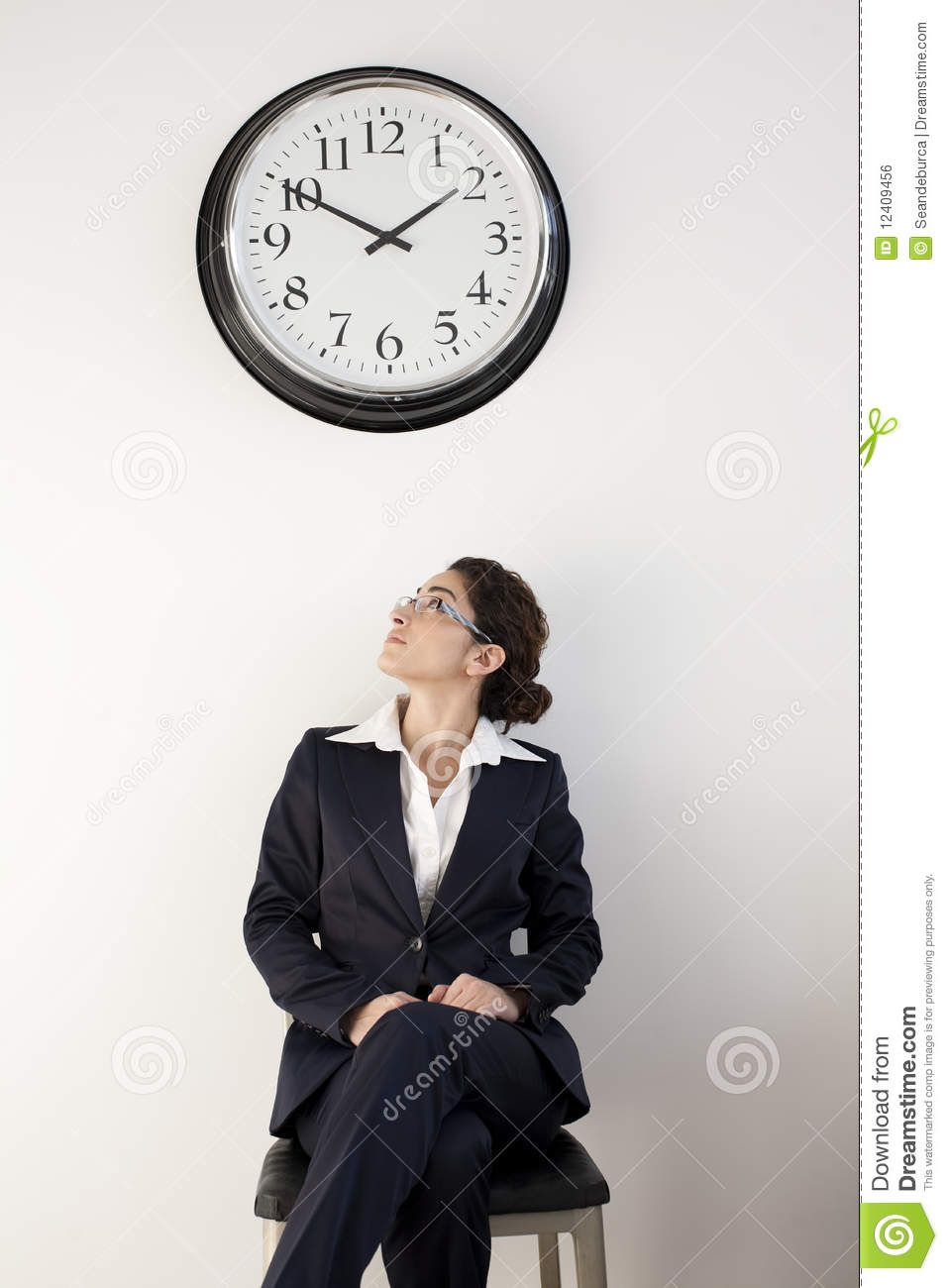 office worker looking at clock stock photo image of away seated