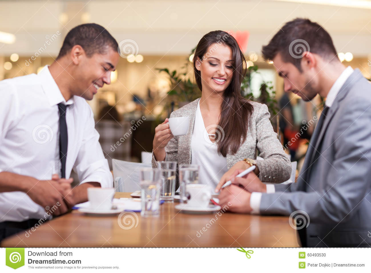 Office workers on coffee break, woman enjoying chatting to colle