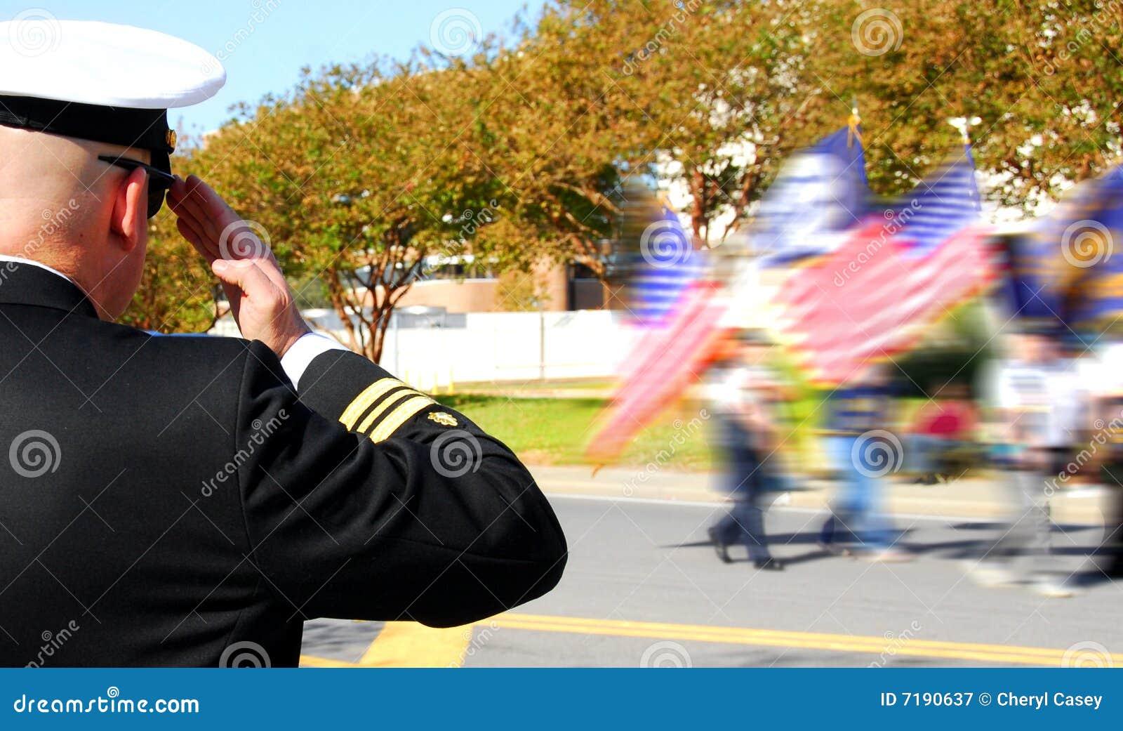 Officer saluting veterans