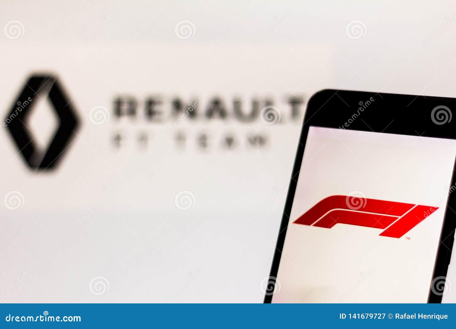 Officiële F1 FIA Formula 1 embleem op het mobiele apparatenscherm Het Teamembleem van Team Renault F1 op achtergrond
