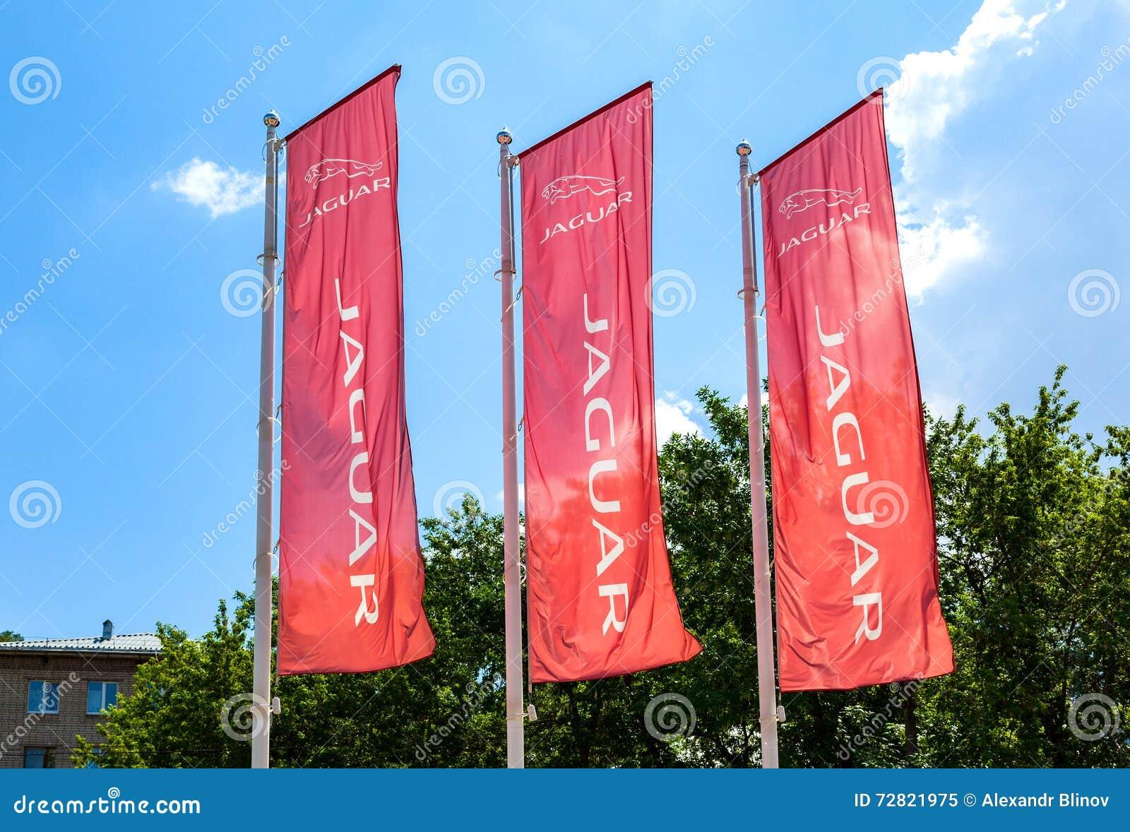 Official Dealership Flags Of Jaguar Against The Blue Sky Backgro