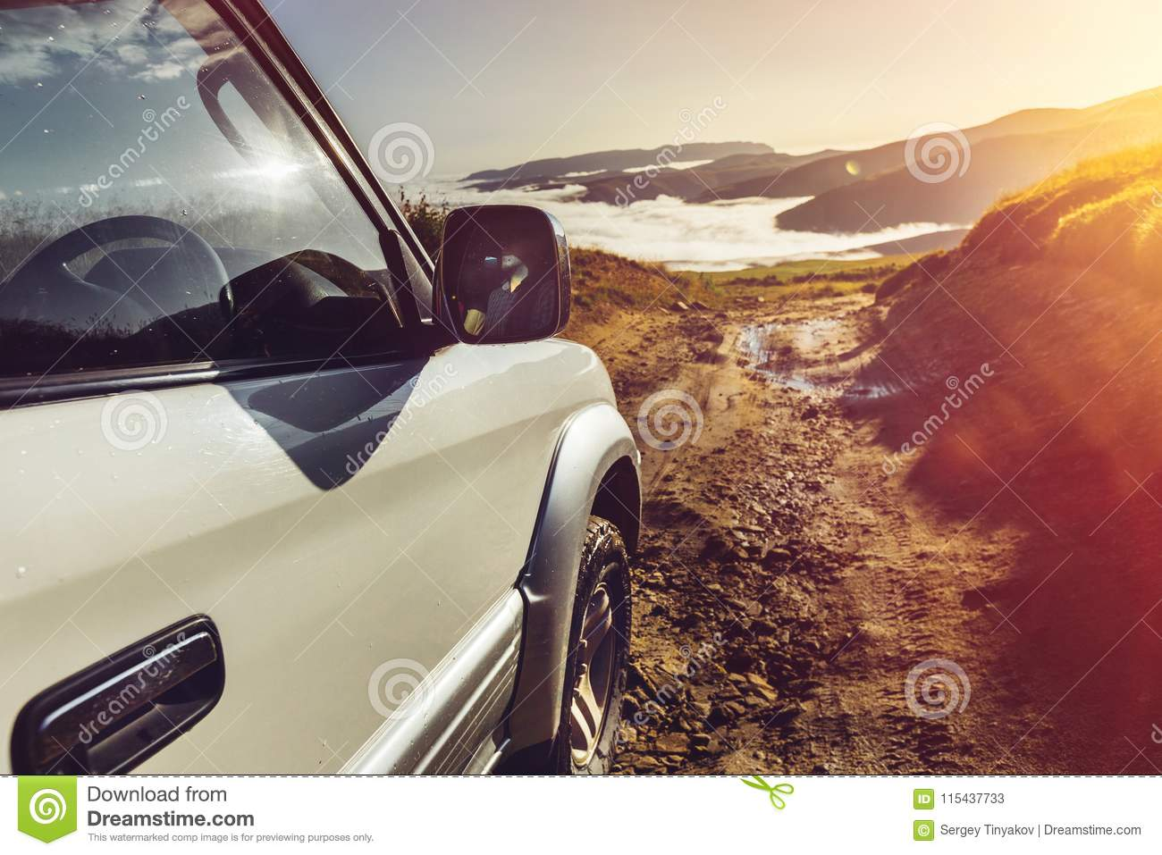 Offroad Car On Mountains And Clouds Background. Road Adventure V
