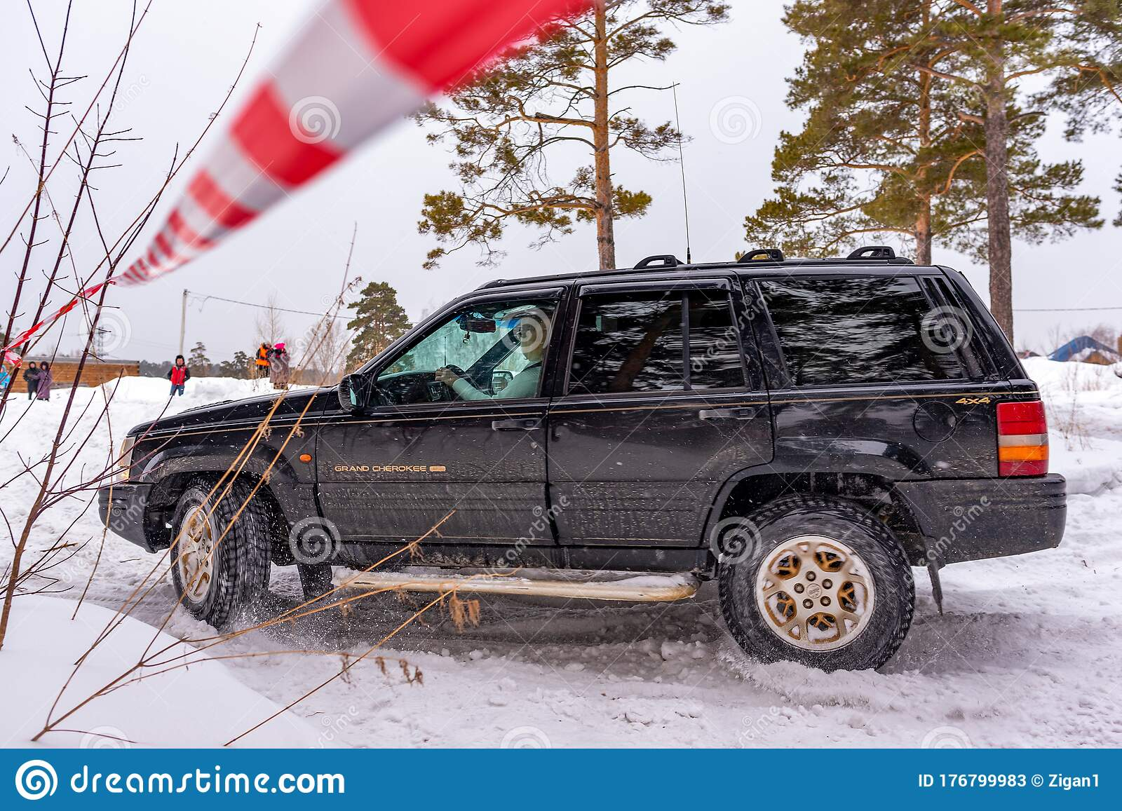 Offroad Suv Jeep Grand Cherokee 4x4 Black Color Rides In Winter On Snow In The Forest Among Pines And Striped Tape Editorial Stock Photo Image Of Pastime Holiday 176799983