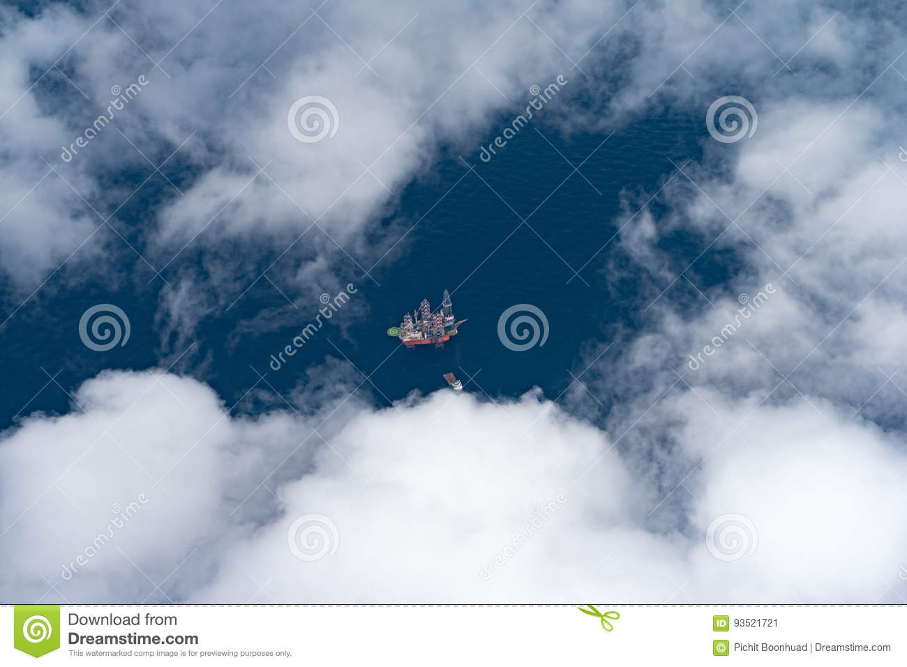 Offshore Oil And Gas Drilling Rig At Deep Sea With Supply Boat While