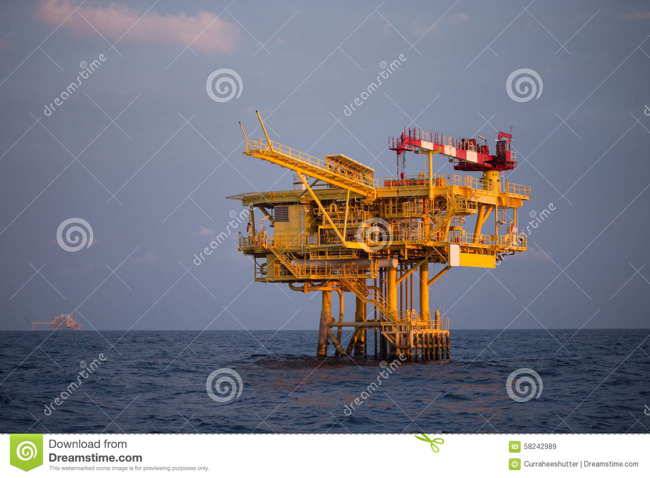 Offshore Oil And Rig Platform In Sunset Or Sunrise Time