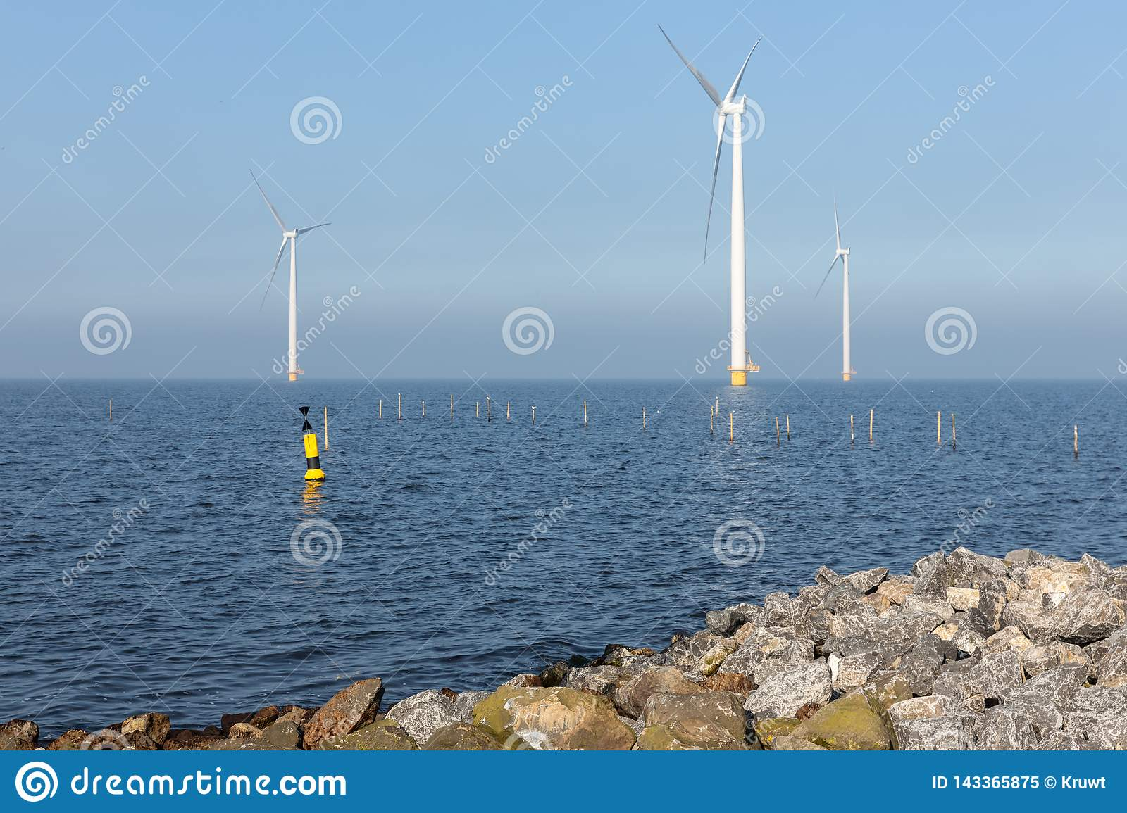 Offshore wind turbines near Dutch coast with buoy