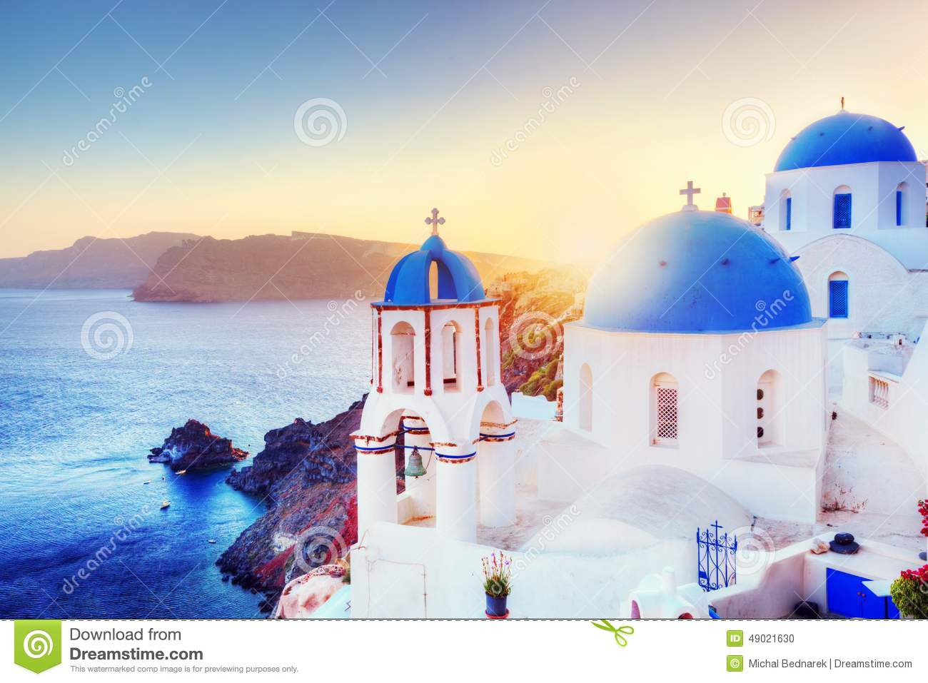 Oia town on Santorini Greece at sunset. Aegean sea