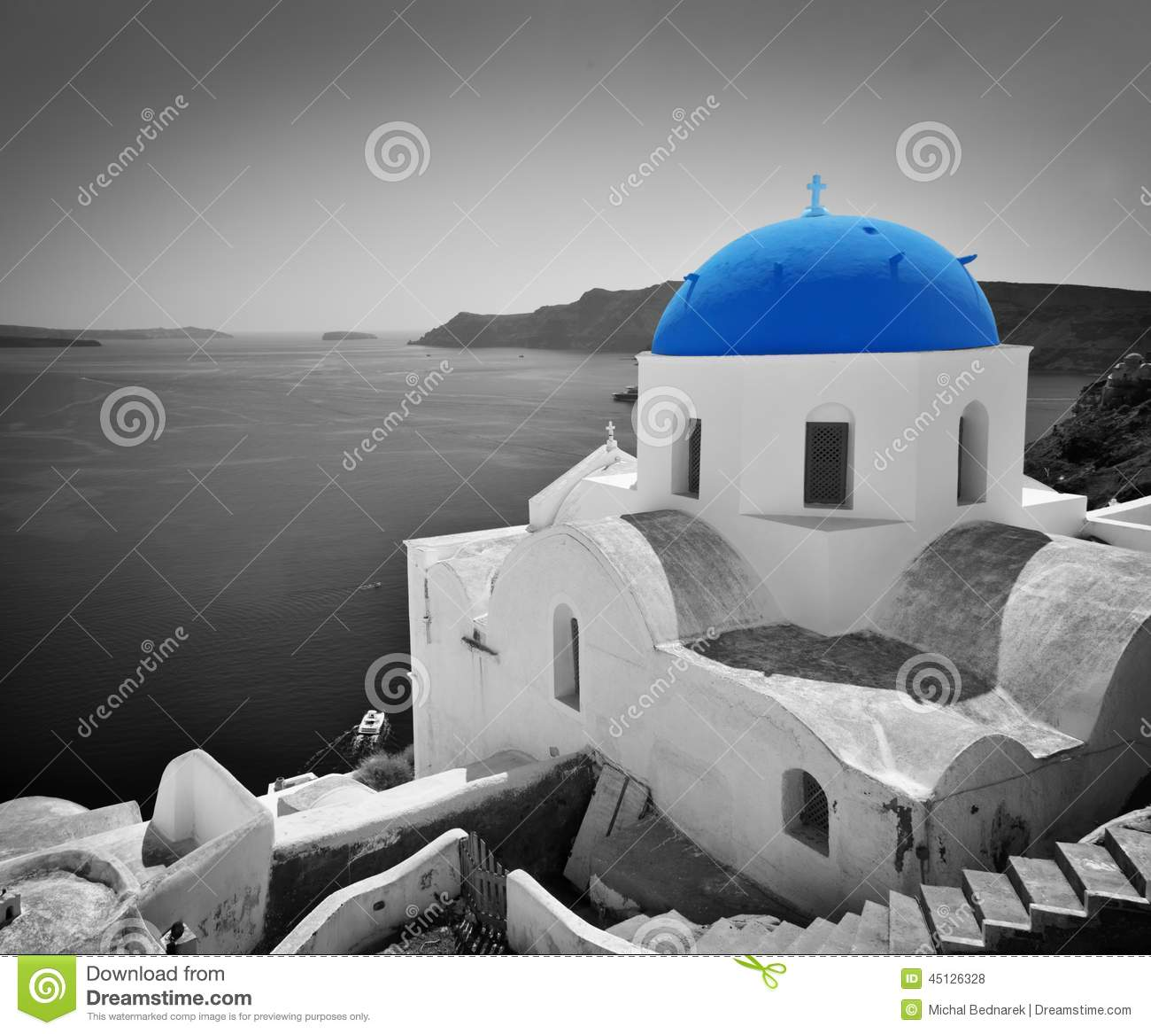 Oia town on Santorini island, Greece. Blue dome church, black and white.