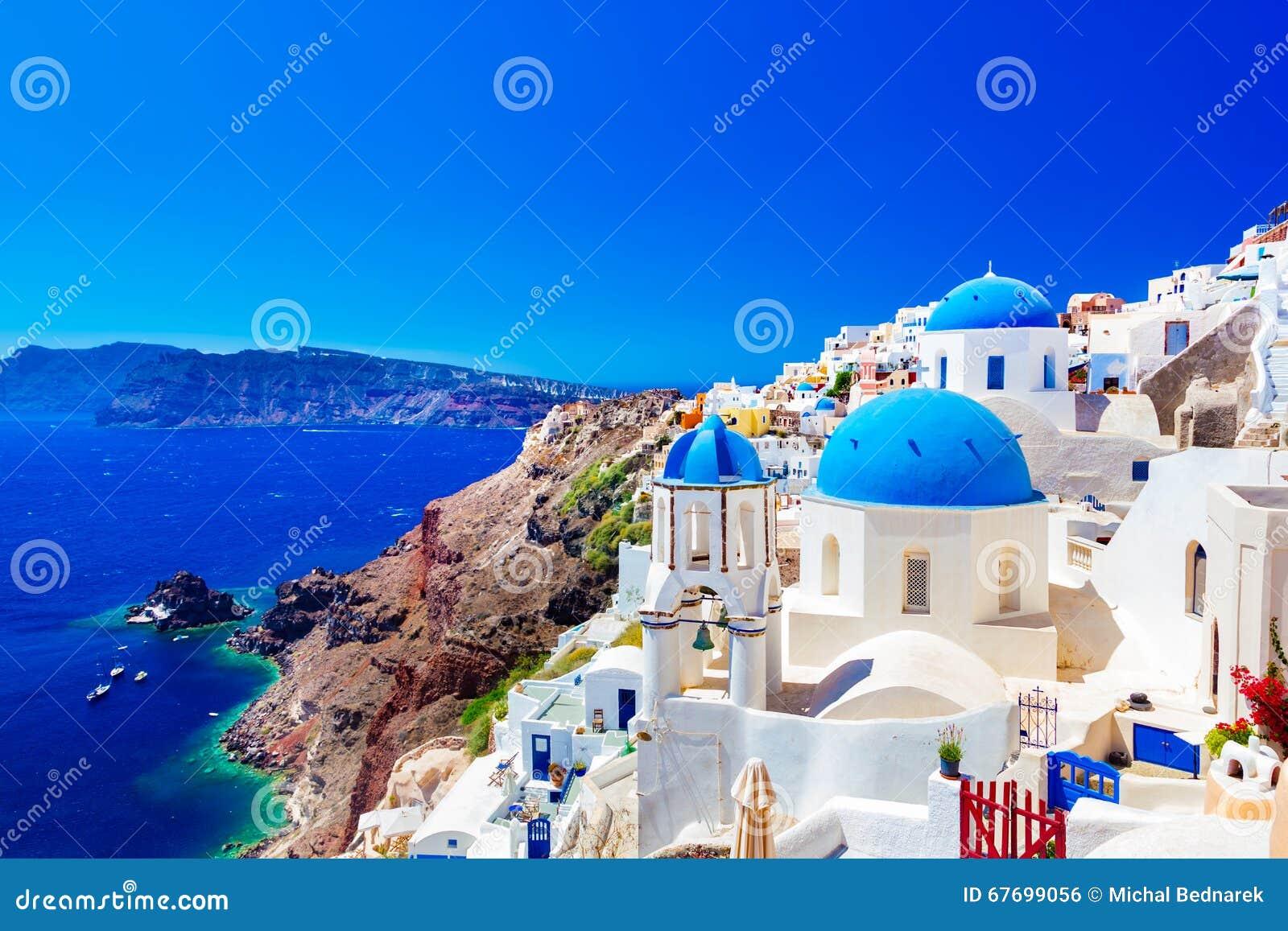 Oia town on Santorini island, Greece. Caldera on Aegean sea.