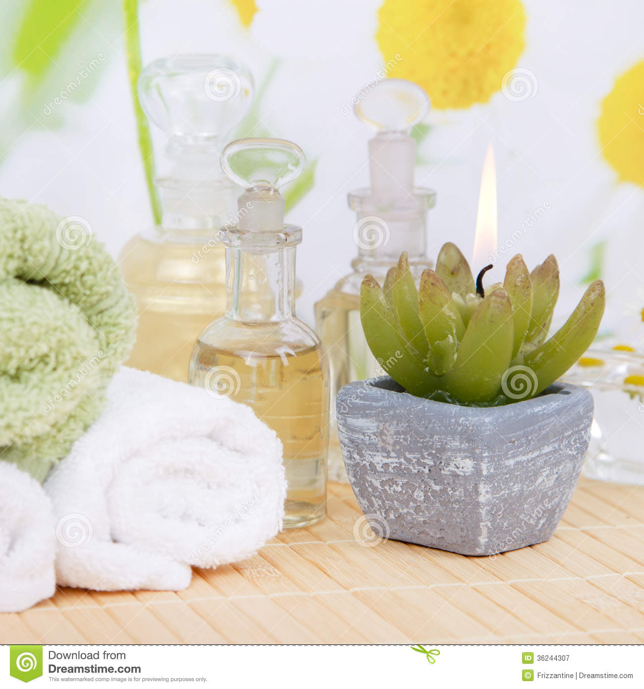 oil and chamomile - spa decoration in white and yellow royalty