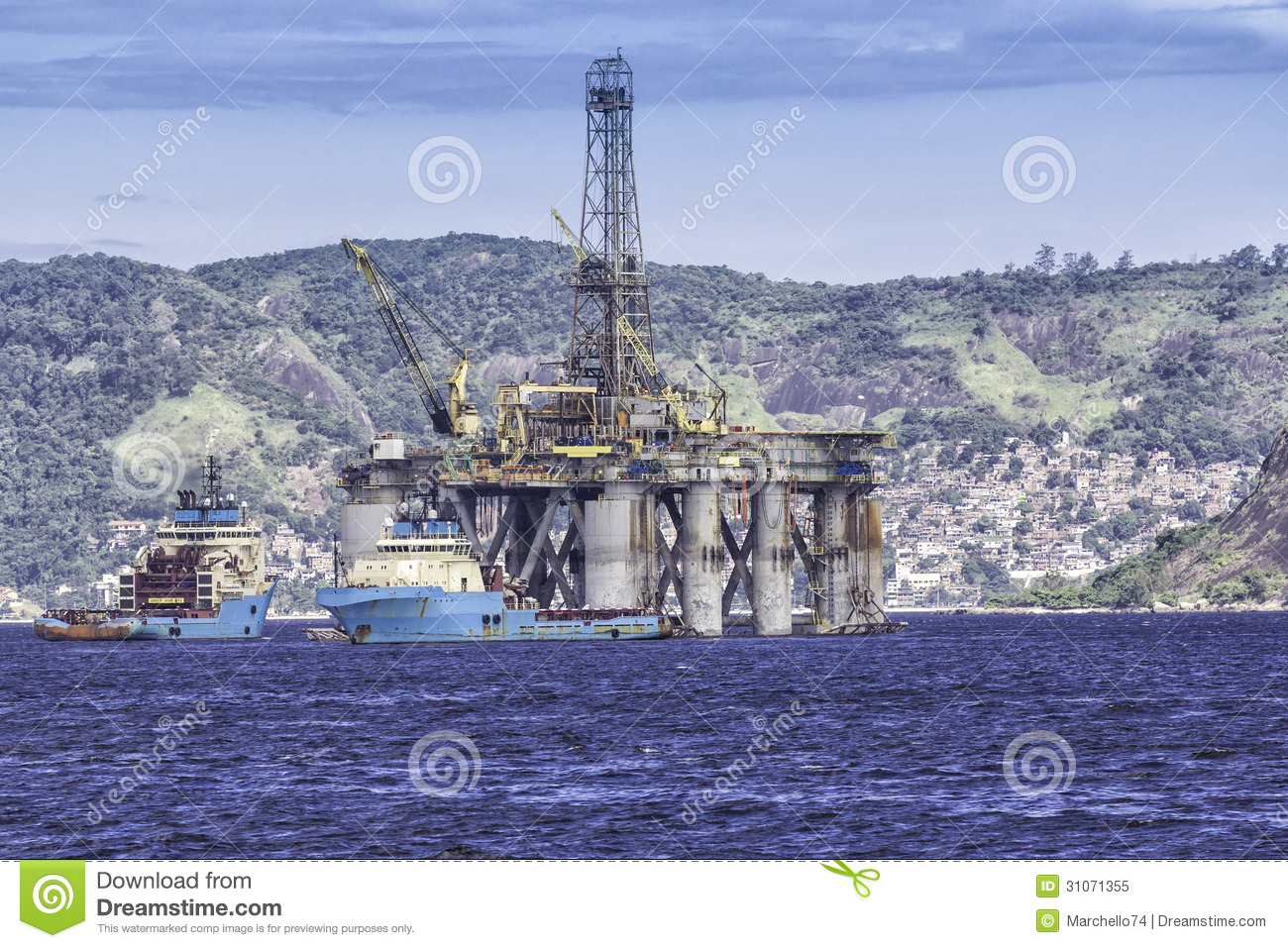 Oil drilling rig against panorama of Rio de Janeir