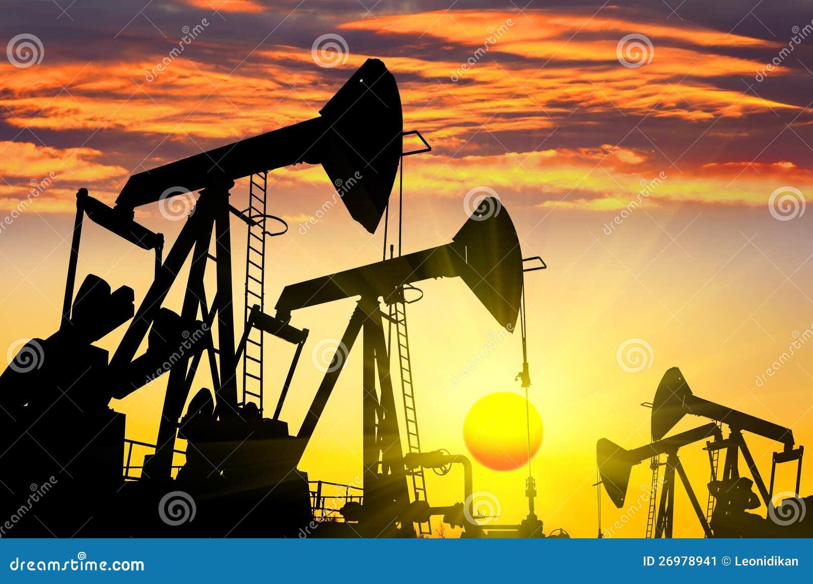 Silhouettes of oil pum...