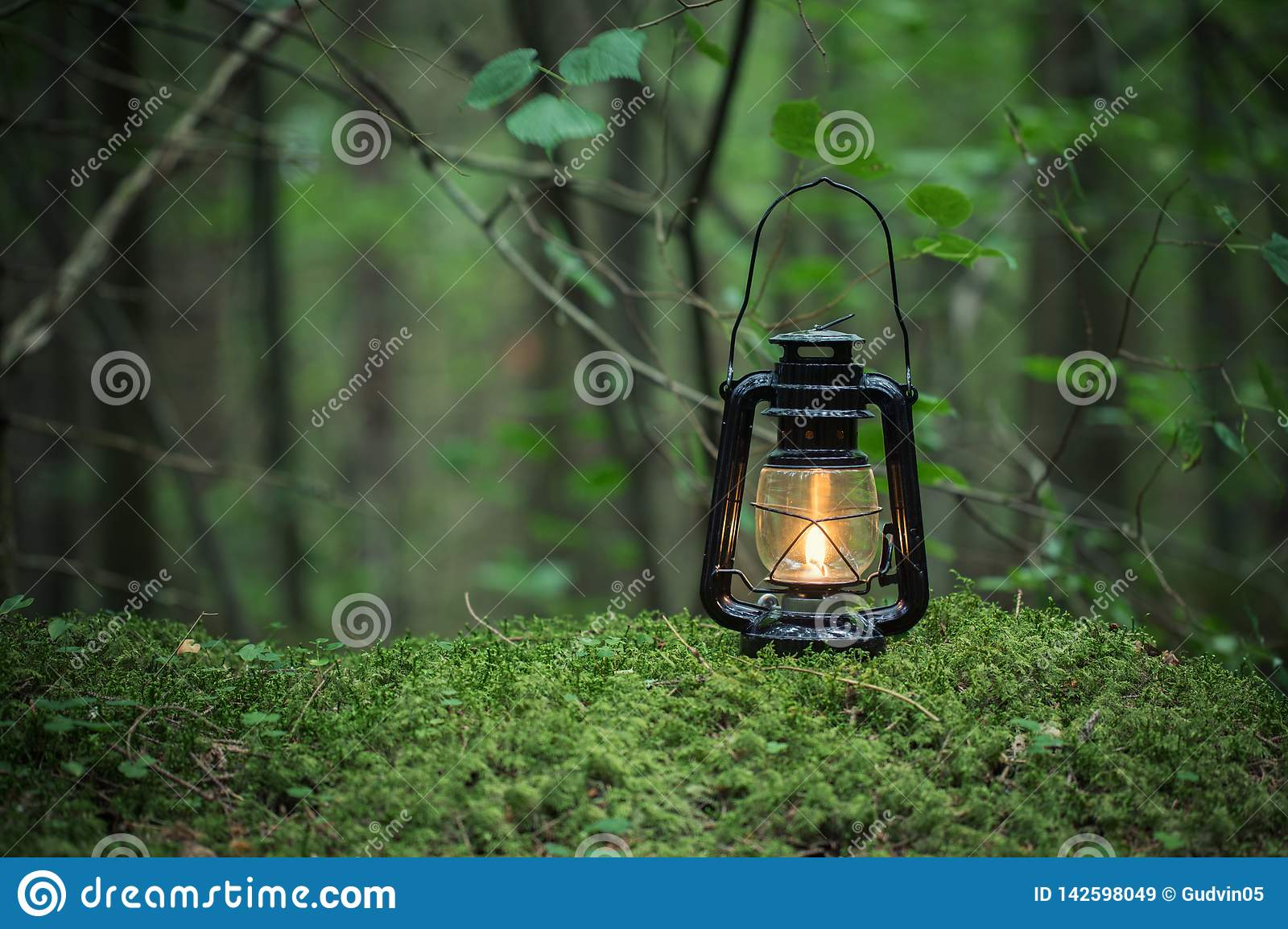 Oil lamp on the ground in nature