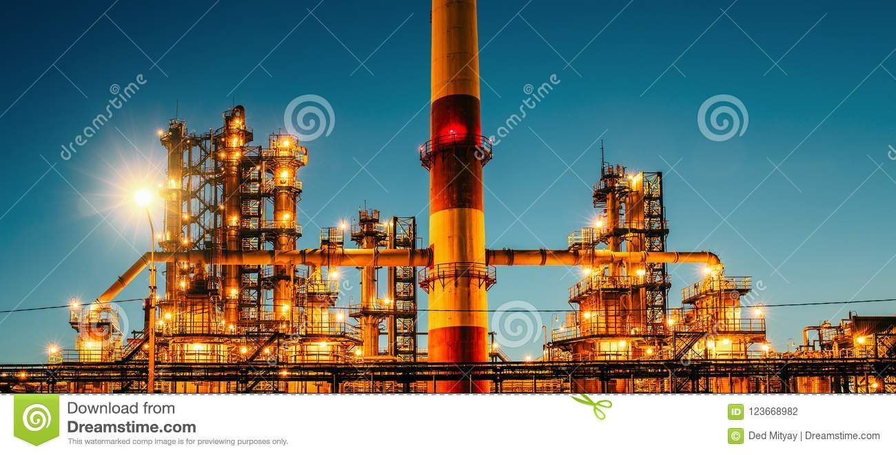 Oil refinery industrial plant or factory at sunset, storage distillery tanks and steel pipeline, modern petrochemical technologies