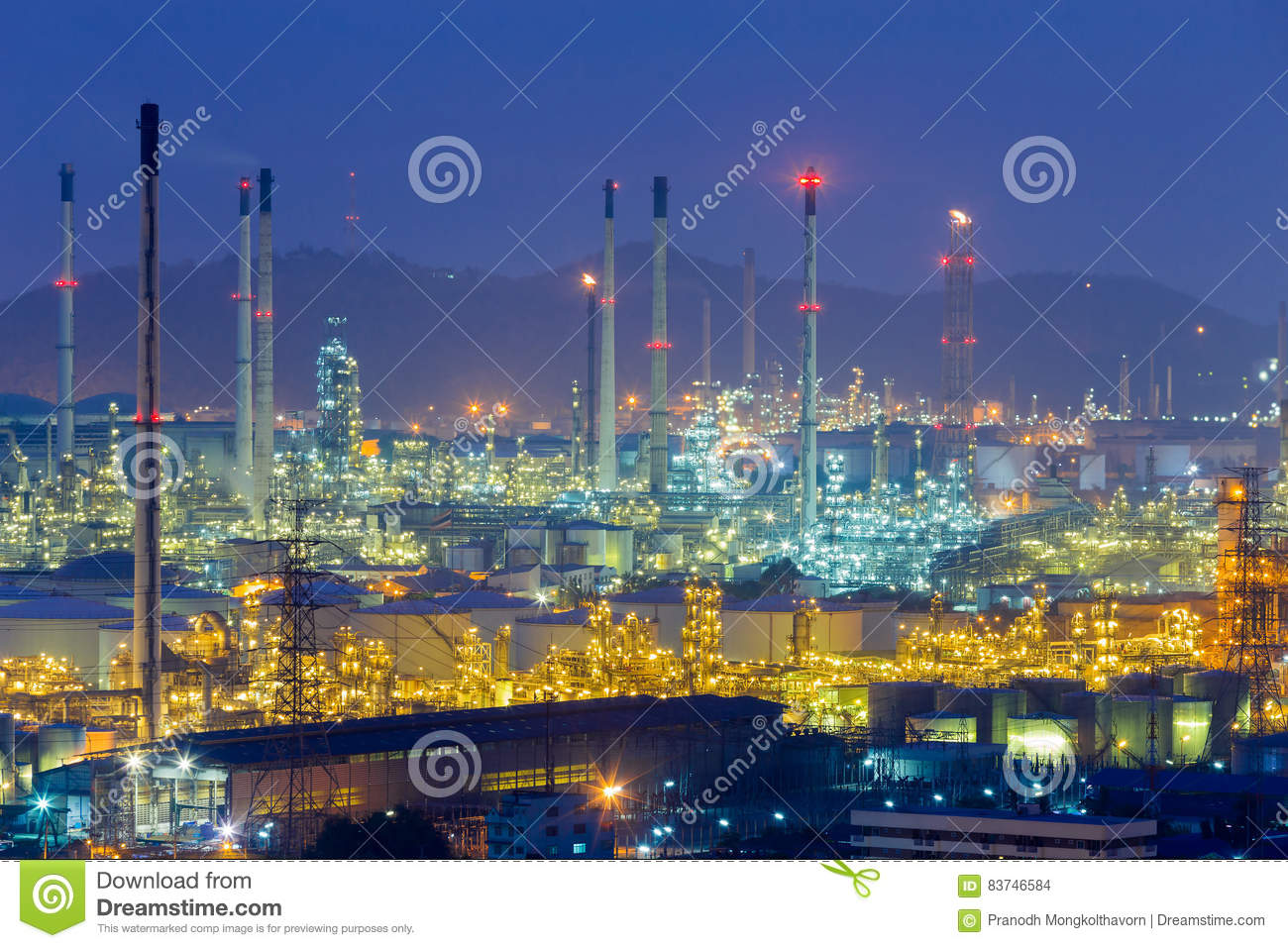 oil-refinery-lights-night-view-mountain-