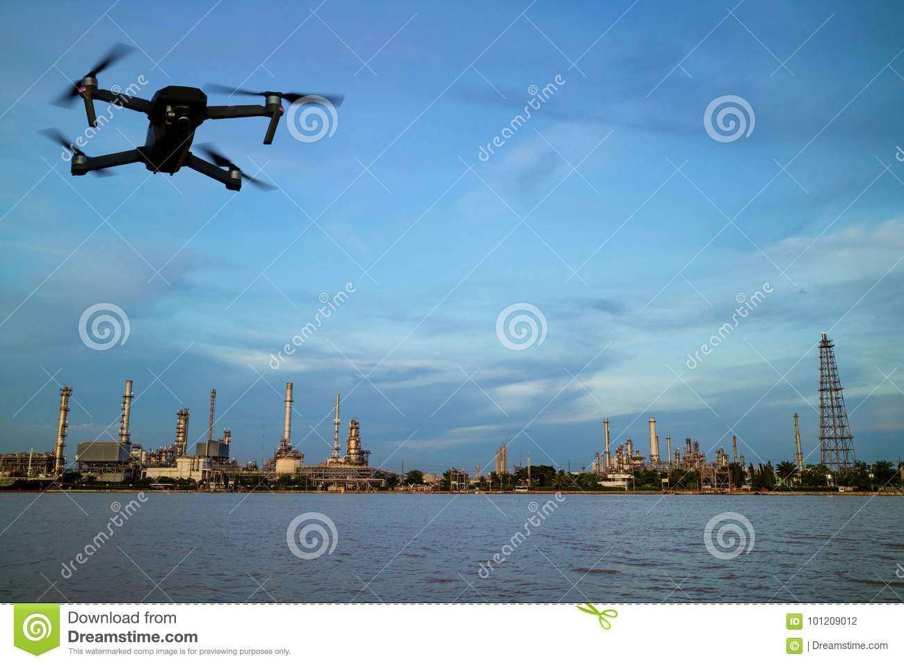 Oil refinery plant near river and drone
