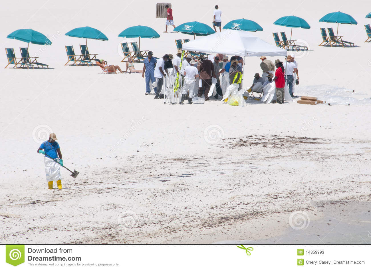 Oil spill workers cleaning beach