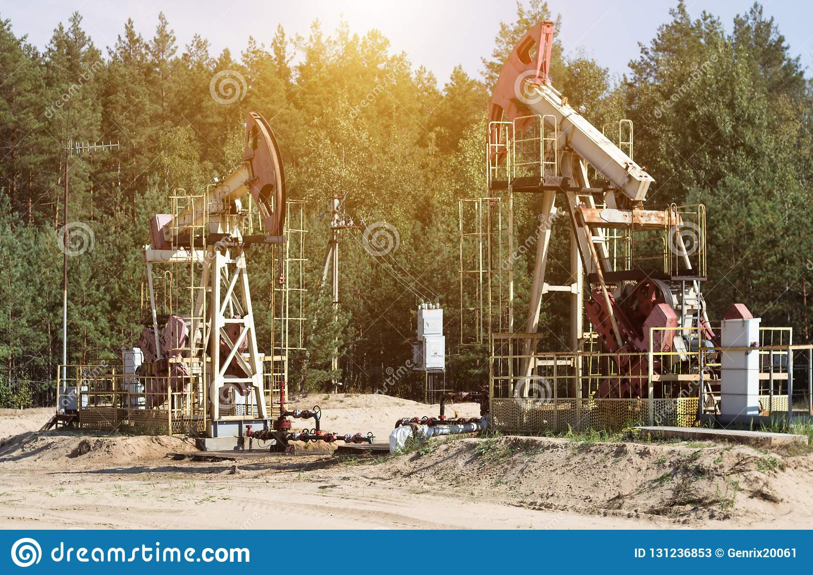 Oil well for the production of oil and gasoline and gas on the background of the forest, the production of gasoline, pumpjack