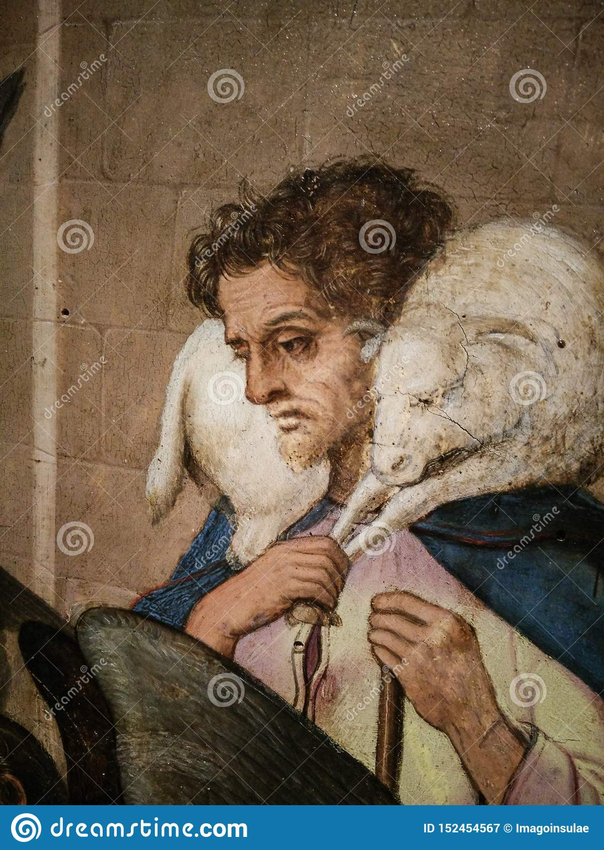 Italy. Artistic heritage. Nativity, work by Master of Bolea. Detail with a shepherd than carries a sheep on shoulders