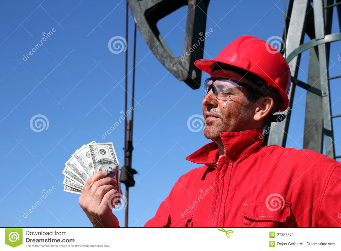 Oil Worker With Dirty Face Holding US Dollar Bills Stock ...