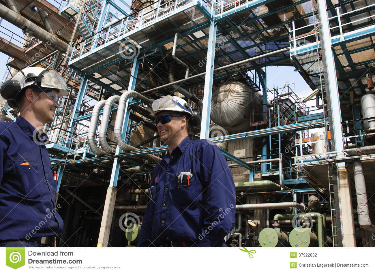 Oil Workers Inside Large Chemical Refinery Stock