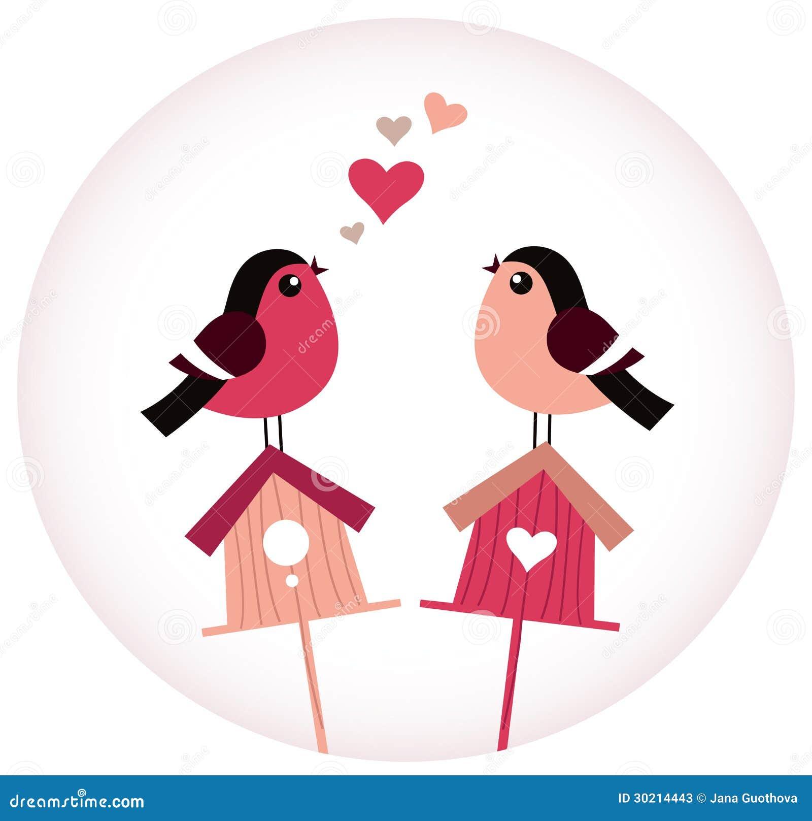 Oiseaux mignons dans l amour se reposant sur des volières