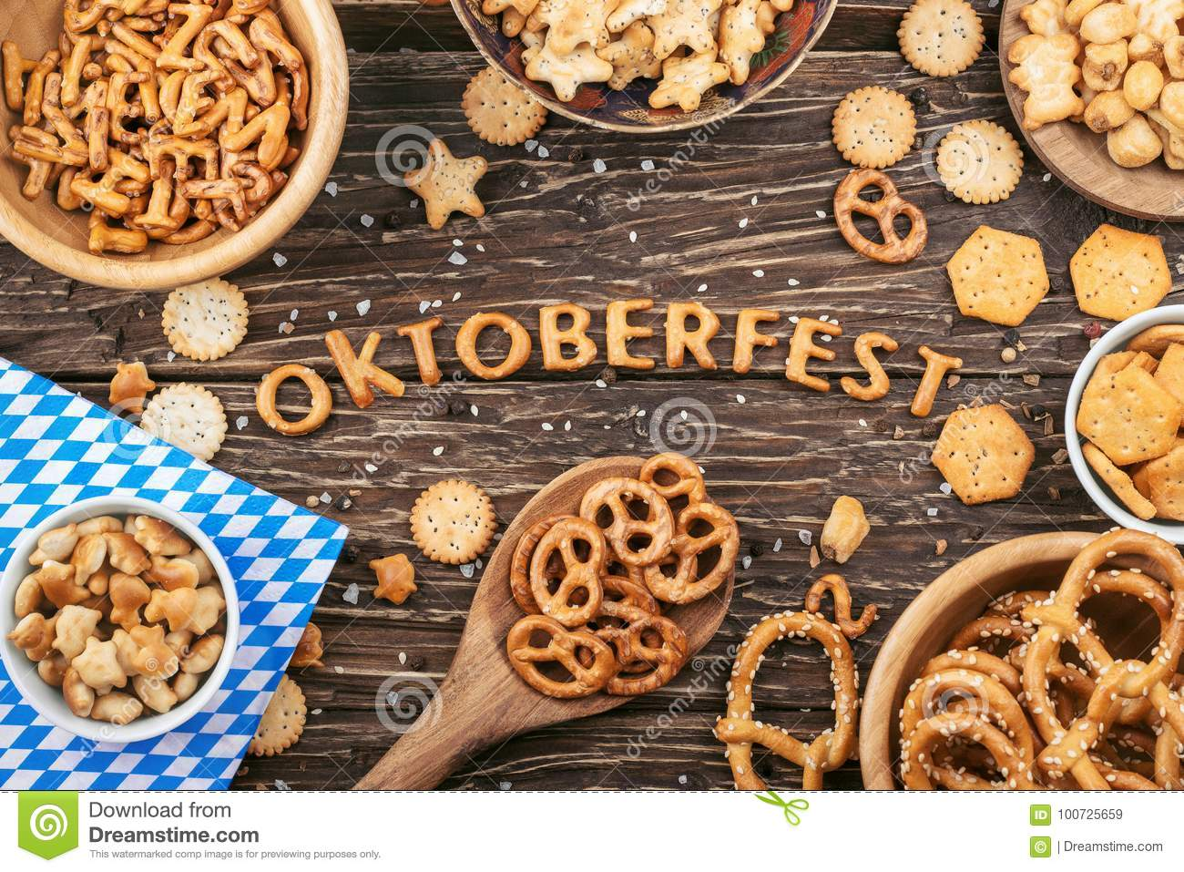 Oktoberfest lettering. Salty crackers, pretzels and others snack