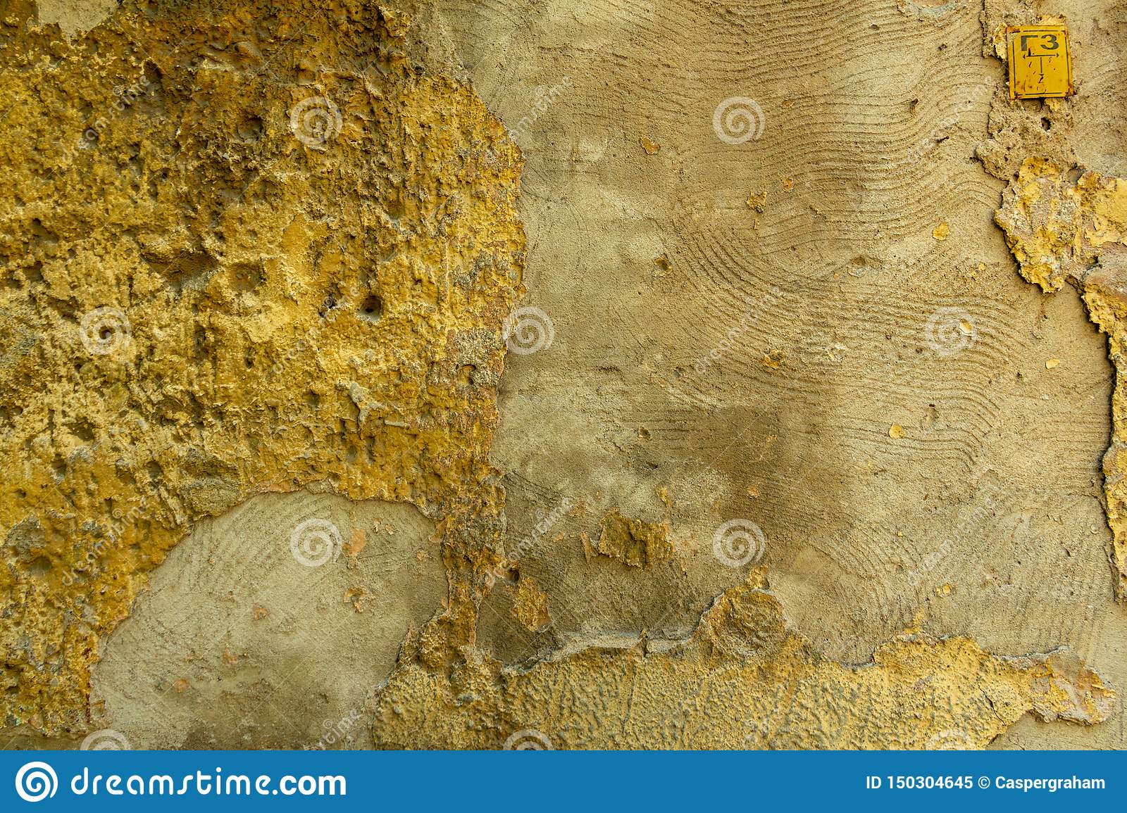 Wall of concrete and brick with plaster texture