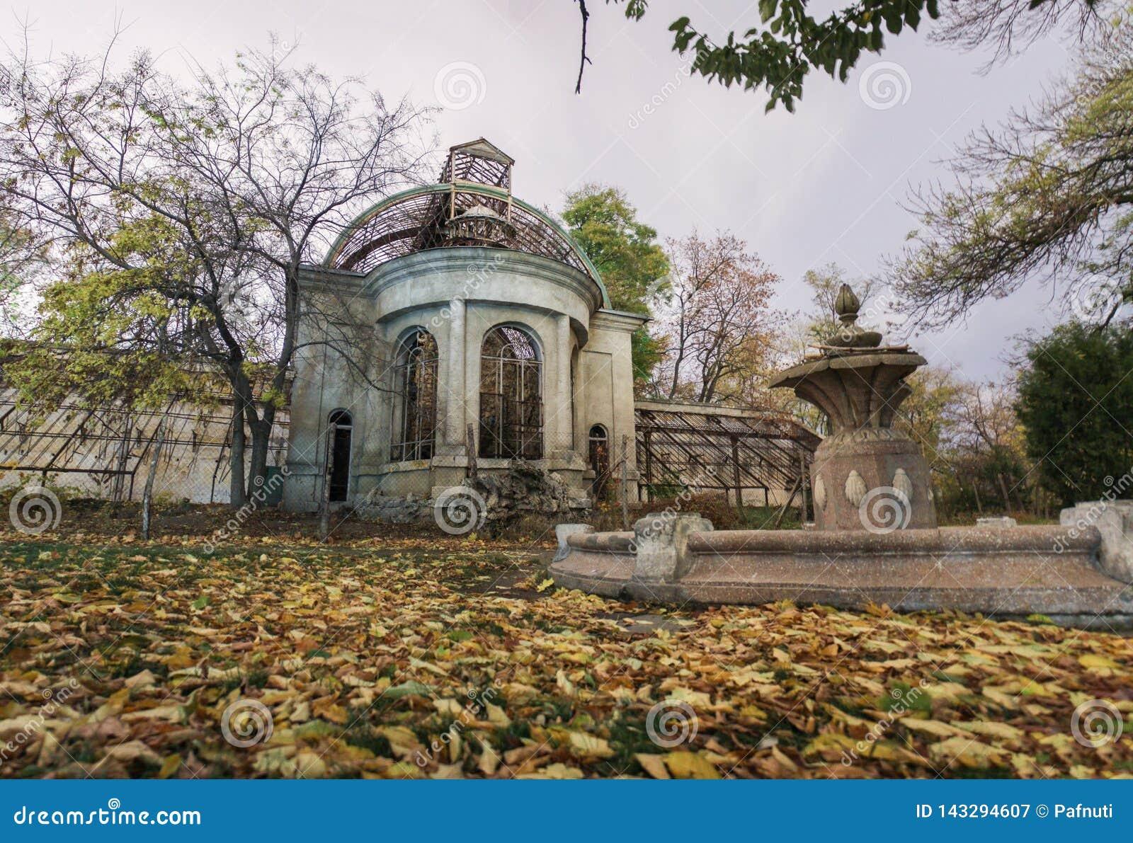 Old abandoned haunted house. Fallen foliage