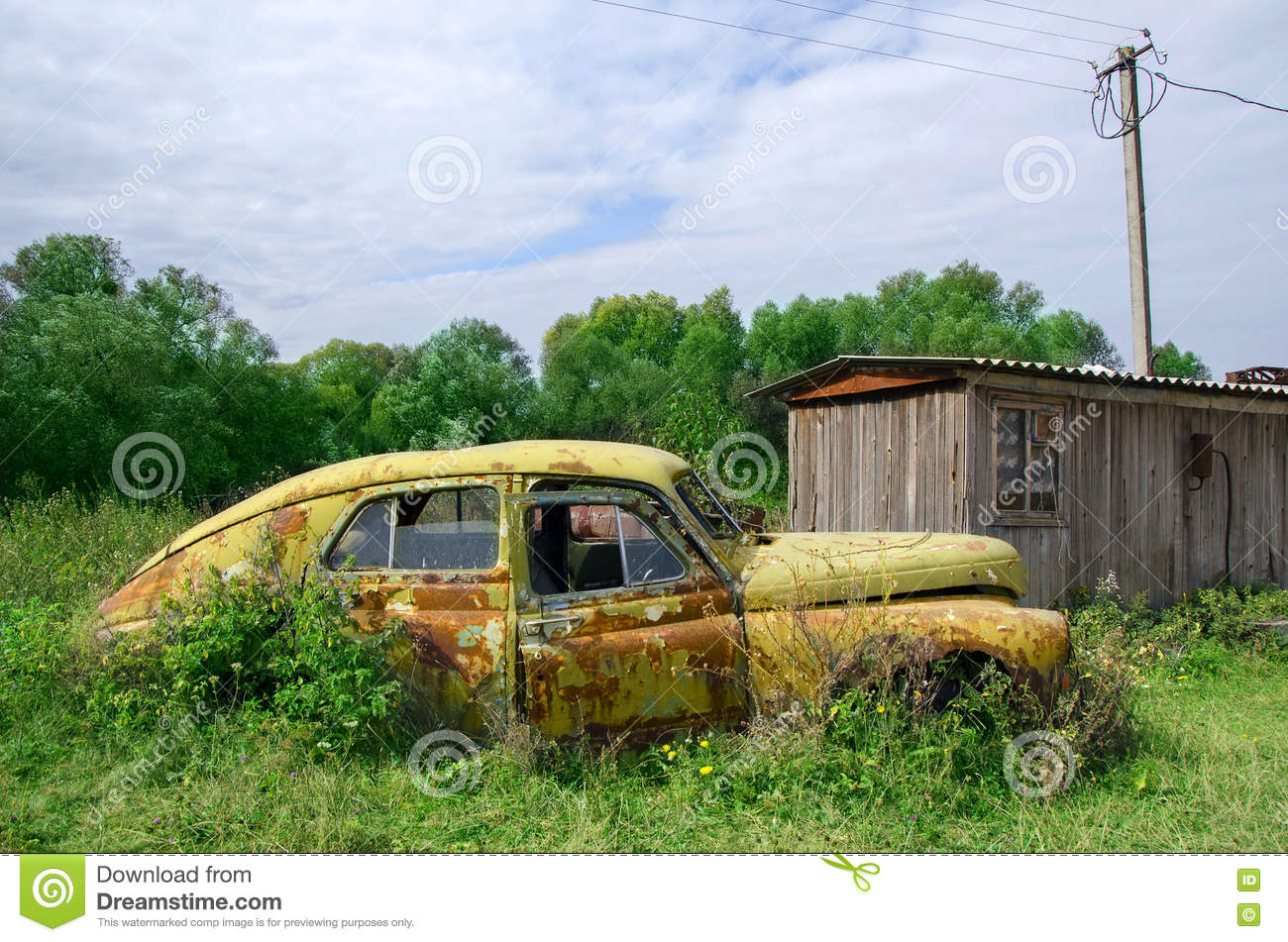 Old abandoned rustic yellow car