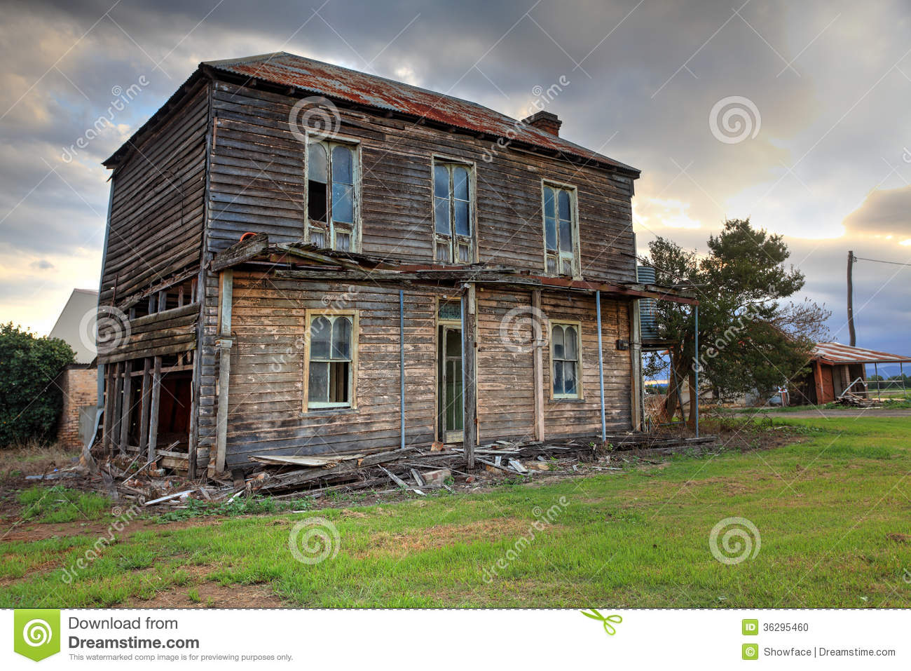 Old Abandoned Two Storey Wooden Farmhouse Stock Photo