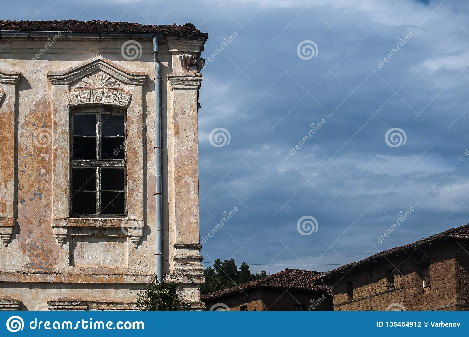 Old abandoned weathered house facade