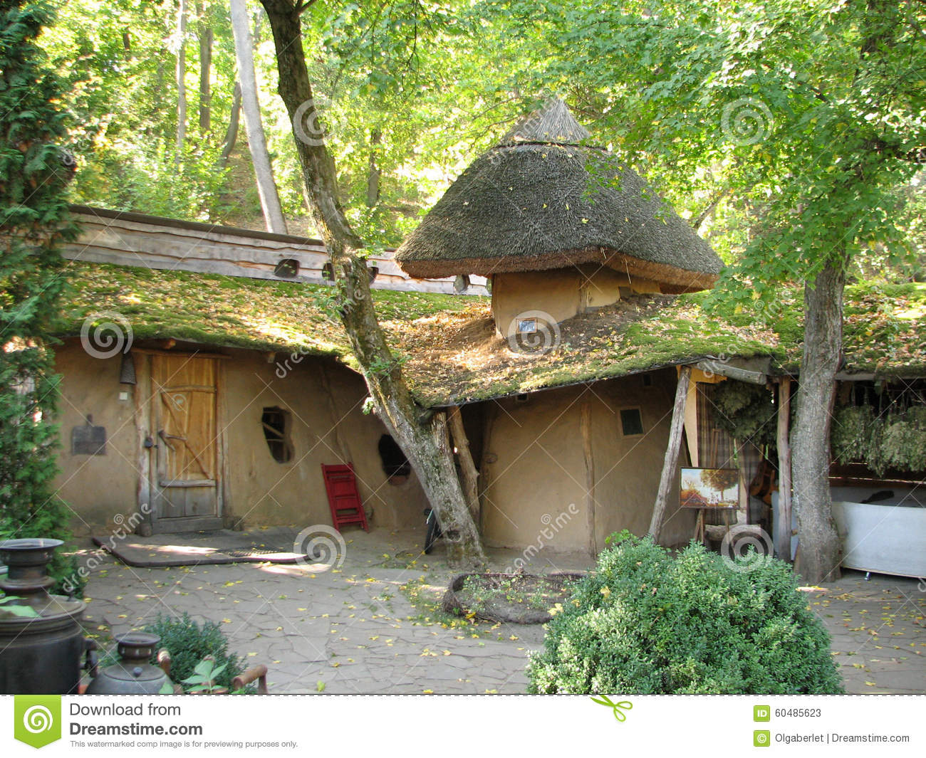 The old adobe house with a thatched roof stock photo for Adobe roof