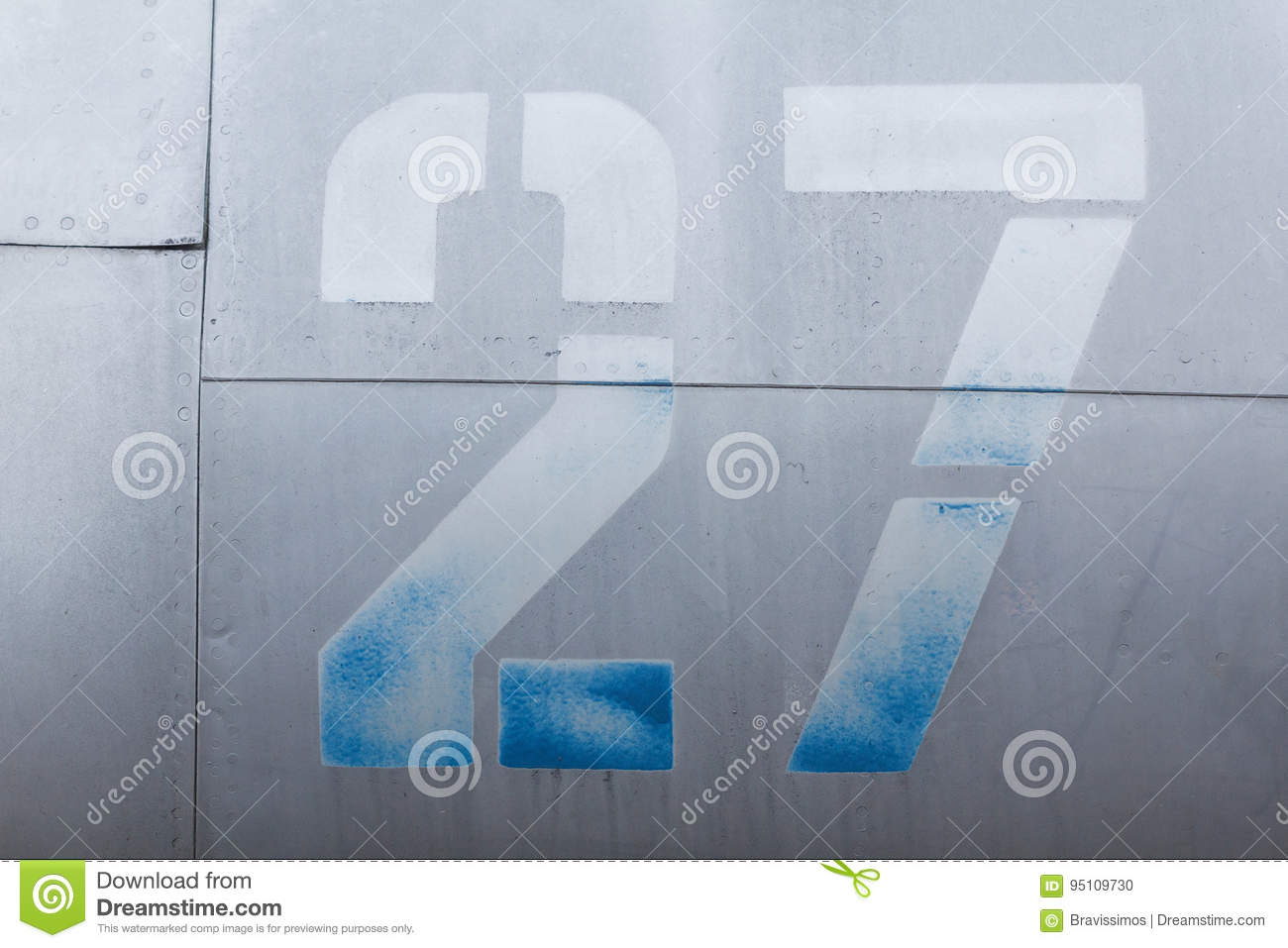 Old aluminum background detail of a military aircraft, surface corrosion.