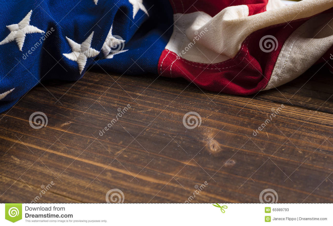 Old American Flag On Wooden Plank Background Stock Image