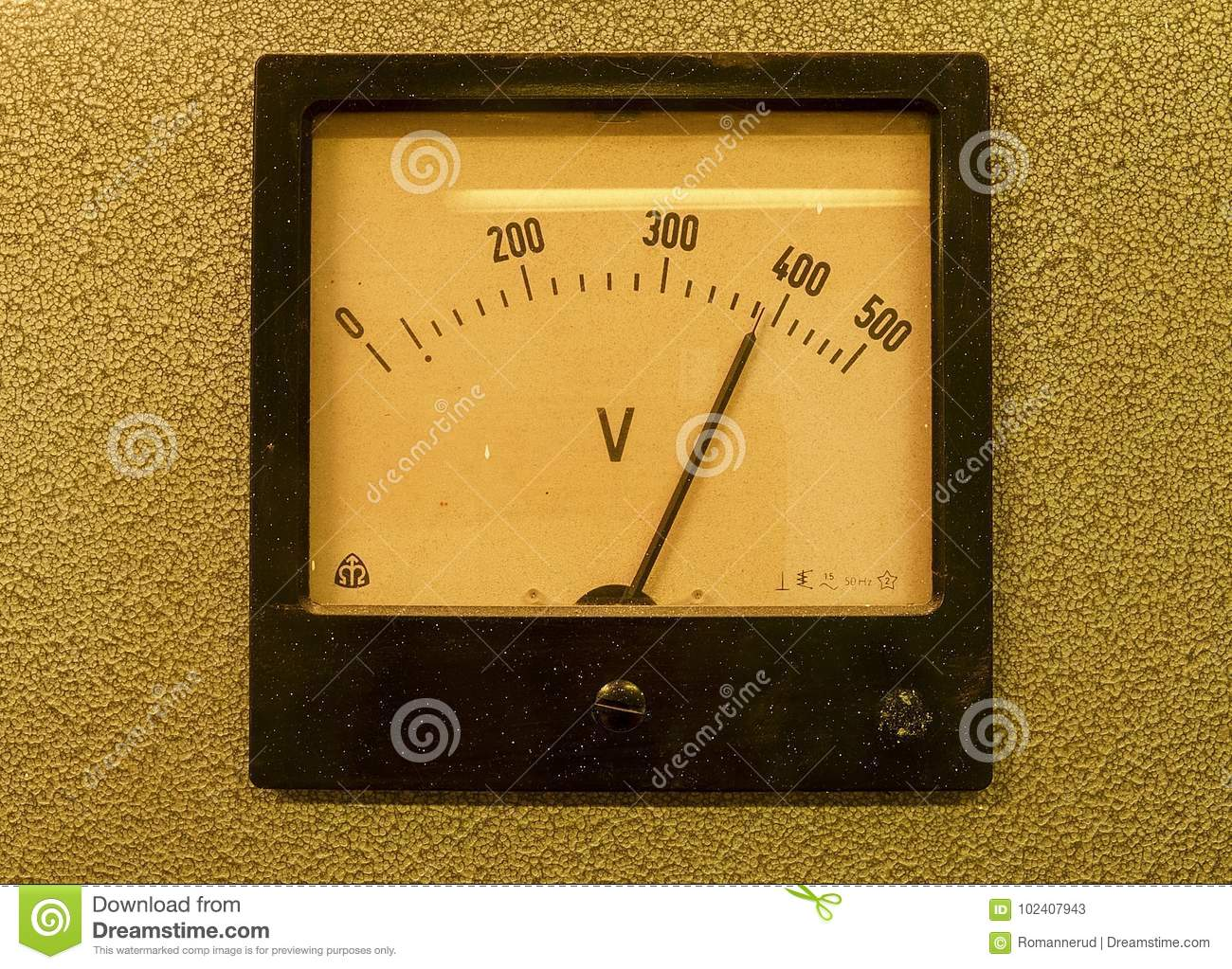 Old analog volt meter. Old measuring instrument with arrow and white scale