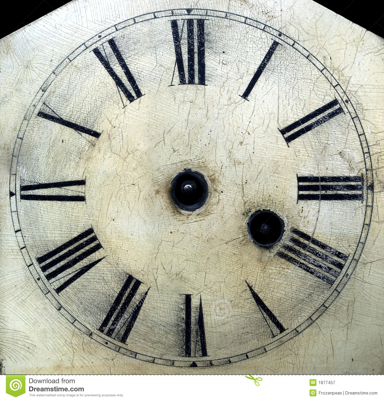 Old antique clock face with hands removed close-up detail.