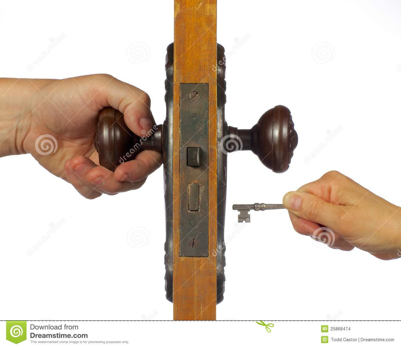 Old antique door being open with skeleton key. - Old Antique Door Being Open With Skeleton Key. Stock Photo - Image