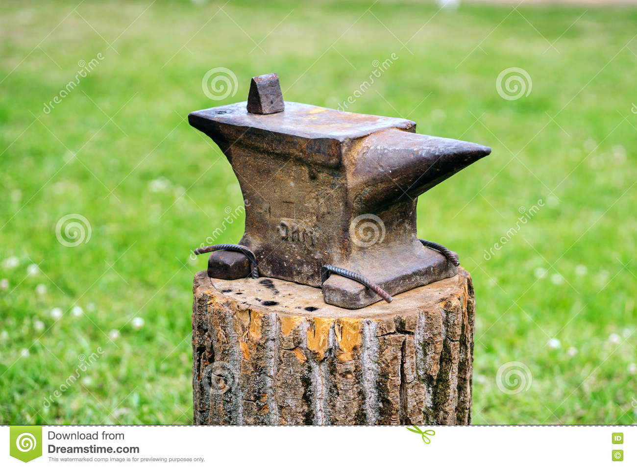 The old anvil is on the stump.
