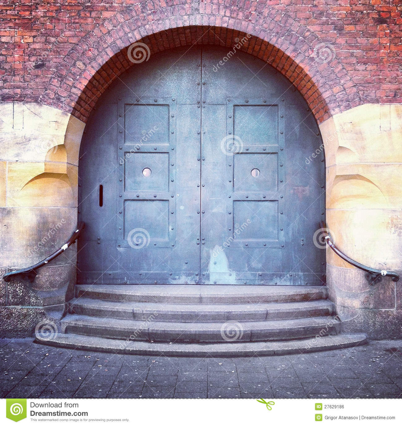 Old arched door and steps