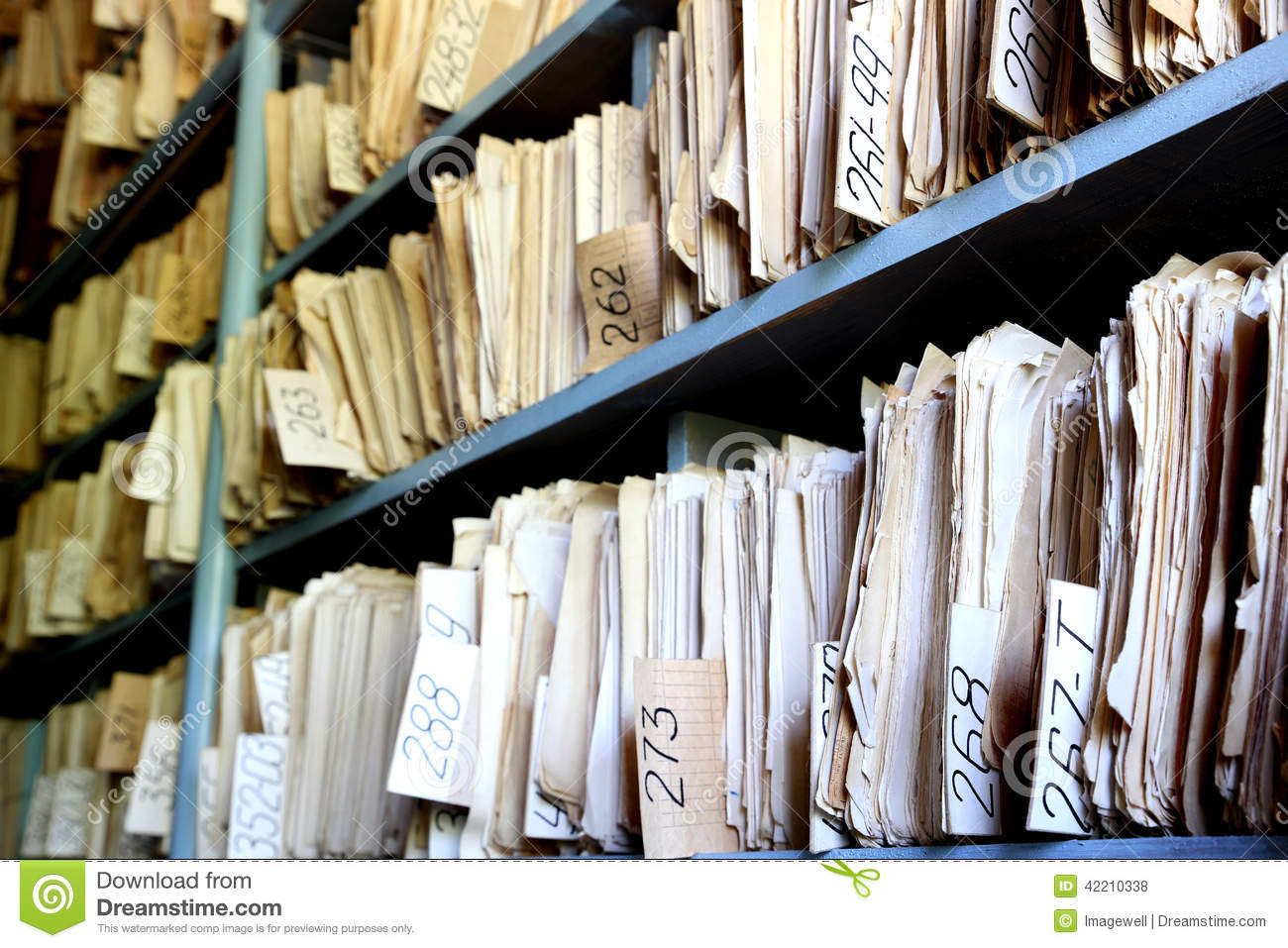 Shelves full of files in a messy old-fashioned archive.