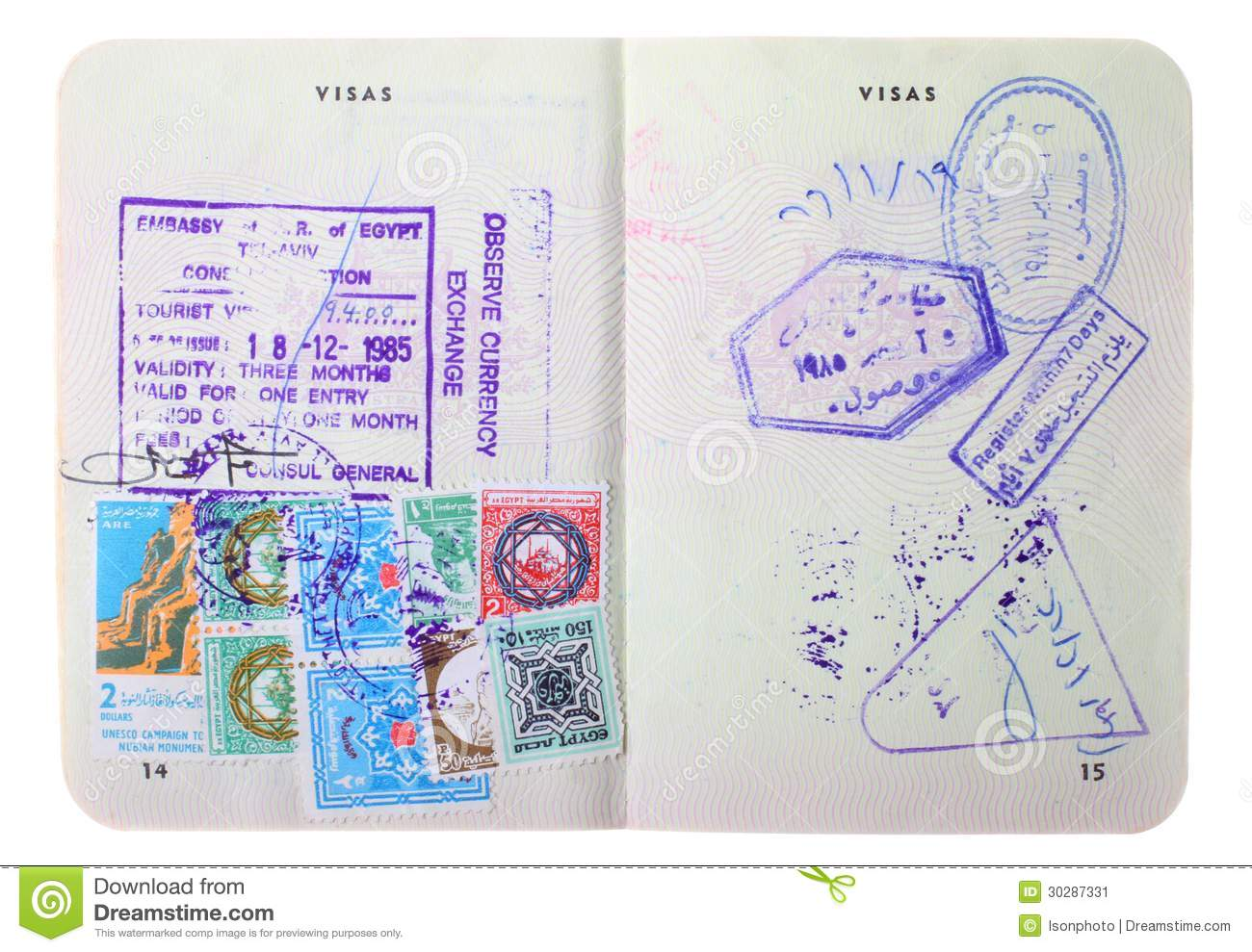 Old Australian Passport With Visa Stamps For Egypt On The Pages Isolated White Background